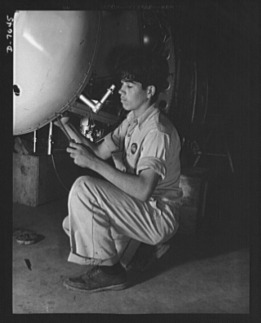 Naval air base, Corpus Christi, Texas. A Mexican neighbor, who crossed the border, now works under U.S. Civil Service in the assembly and repair department of the naval air base at Corpus Christi, Texas. Formerly he was a laborer in a warehouse