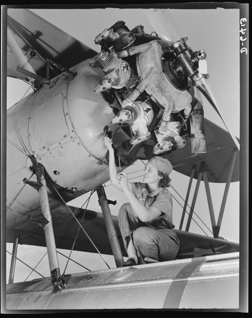 Naval air base Corpus Christi, Texas. A top-notch mechanic, Mary Josephine Farley, expertly rebuilds airplane engines. Although she's only twenty-years-old, she has a private pilot's license and has made several cross-country flights. She ranked highest of all competitors on her civil service examination with a grade of 89. Since her arrival at the Corpus Christi Air Base four and one-half months ago, she has been made a crew leader