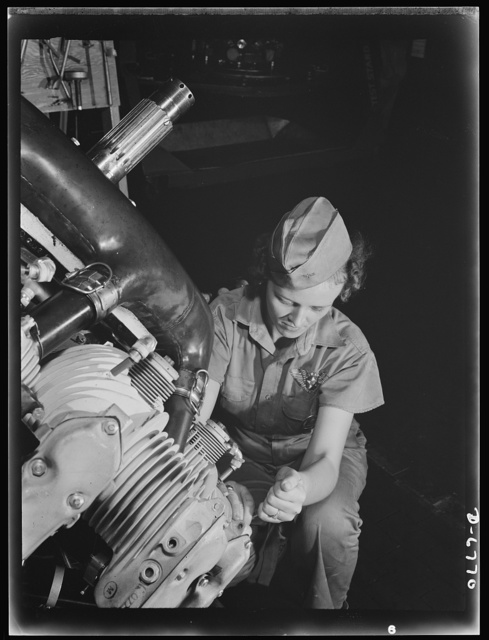 Naval air base, Corpus Christi, Texas. A top-notch mechanic, Mary Josephine Farley expertly rebuilds airplane engines. Although she's only twenty-years-old, she has a private pilot's license and has made several cross country flights. She ranked highest of all competitors on her civil service examination with a grade of eighty-nine. Since her arrival at the Corpus Christi Air Base four and one half months ago, she has been made a crew leader