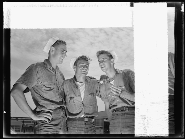 "Naval air base, Corpus Christi, Texas. ""And so he says to me...."" sailor mechanics at the naval air base in Corpus Christi, Texas, laugh heartily over a good story between servicing operations on Navy planes"