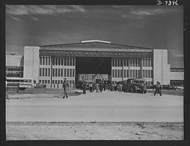 Naval air base, Corpus Christi, Texas. Civil service employees leave the Assembly and Repair Shop at the naval air base in Corpus, Christi, Texas