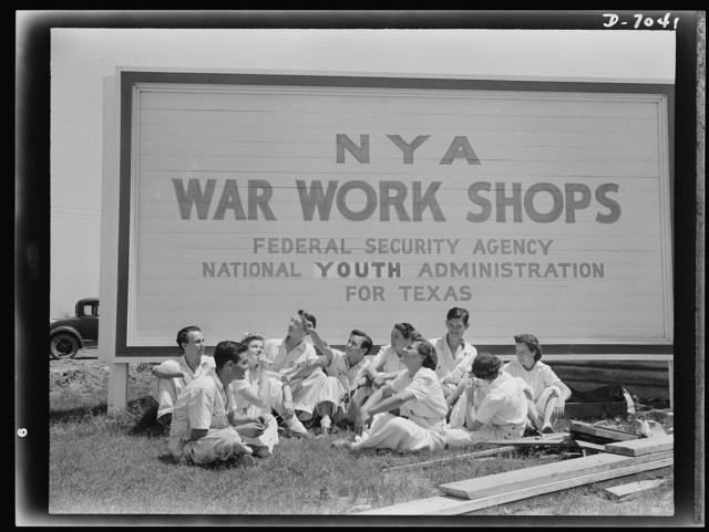 Naval air base, Corpus Christi, Texas. Deep in the heart of Texas, young National Youth Administration (NYA) trainees for war jobs, watch the Navy planes they are learning to service. Wearing their regulation work clothes, these civil service apprentices of the naval air base in Corpus Christi, Texas, are in the vanguard of a large army of youths being trained as maintenance and repair workers at the military air station