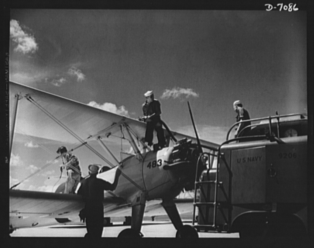 Naval air base, Corpus Christi, Texas. Feuling an N2S, primary land plane, at the naval air base in Corpus Christi, Texas. Sailor mechanics at the base service the ship as a cadet prepares for the take-off