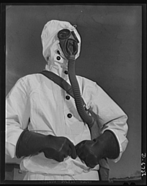 Naval air base. Corpus Christi, Texas. Like a man from Mars, a sailor at the Corpus Christi, Texas, naval air base wears the new type of protective clothing and gas mask designed for use in chemical warfare. These uniforms are lighter than the old type
