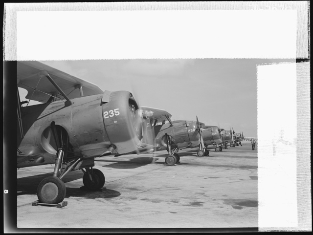 Naval air base, Corpus Christi, Texas. Lined up and looking eager for flight are Navy fighter palnes at the Navy Air Base in Corpus Christi, Texas. These biplane F3F's are constantly reconditioned by sailor mechanics at the base