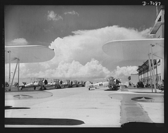 Naval air base, Corpus Christi, Texas. Navy N2S, primary land plane, ready for afternoon flight trips at the naval air base in Corpus Christi, Texas. These ships are completely reconditioned after fulfilling their service schedules by civil service employees at the base