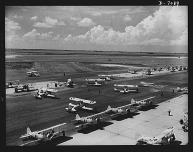 "Naval air base, Corpus Christi, Texas. Navy N2S primary land planes taxi out for a ""rat race"" at the naval air base in Corpus Christi, Texas. Cadets in advanced training have given the race this name"