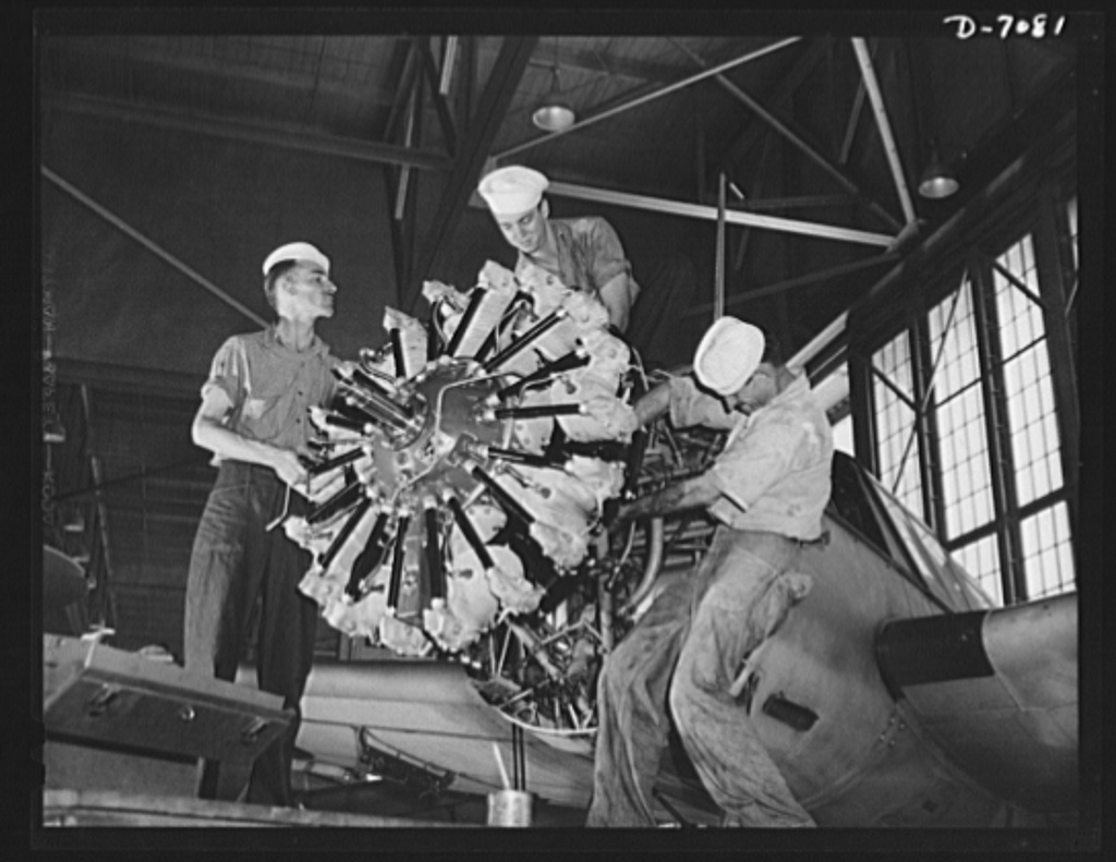 Naval air base, Corpus Christi, Texas. Reconditioning the motors of airplane at the Corpus Christi, Texas, naval air base is being done here by three aviation mechanics mates stationed at the base