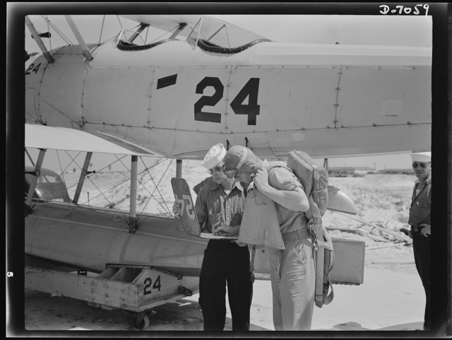 Naval air base, Corpus Christi, Texas. Signing out before taking off. Before each flight, at the naval air base in Corpus Christi, Texas, the yellow flight sheet records are kept at the base. Servicing of the planes is done by sailor mechanics attached to the base