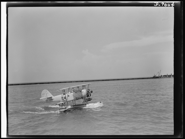 Naval air base, Corpus Christi, Texas. Skimming across the water in a perfect landing, a Navy training ship M2M, approaches the naval air base in Corpus Christi, Texas. This is a type of plane used for training cadets at the base