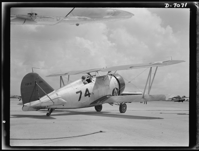 Naval air base, Corpus Christi, Texas. The motor gunned, connections intact, the Navy fighter F3F are constantly reconditioned by sailor mechanics at the base