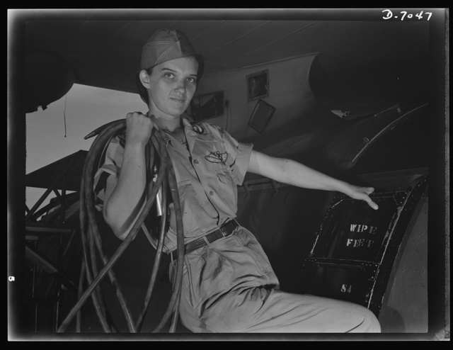 Naval air base, Corpus Christi, Texas. With a woman's determination, Lorena Craig takes over a man-sized job. Before she came to work at the naval air base in Corpus Christi, Texas, Lorena was a department store girl. Now she is a cowler under Civil Service