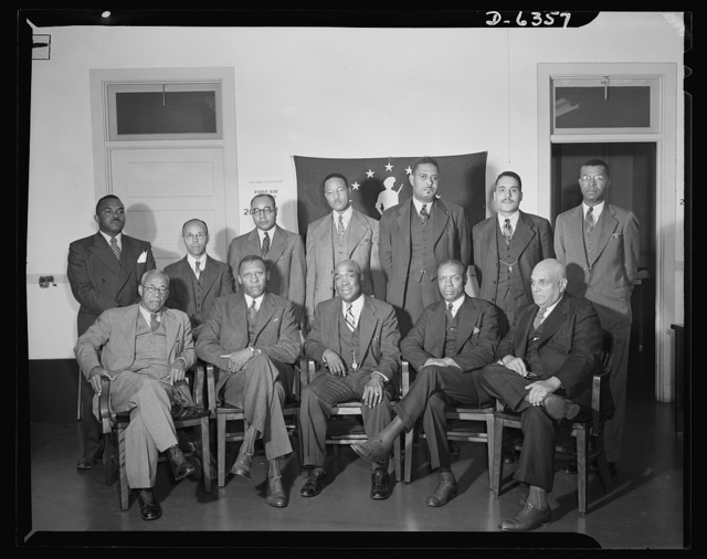 Negro treasury deputies on War Bond staff. Negro deputies in the Treasury Department, appointed to work among farmers and rural families selling war bonds, in Washington for a special intensive training course on October 22 and 23, 1942. Seated, left to right: Preston S. Bowles, Alcorn A&M College, Alcorn, Mississippi; T.M. Campbell, Tuskegee Institute, Tuskegee, Alabama; J.O. Thomas, War Savings staff, Washington D.C.; William Perkins, War Savings staff, Washington D.C.; R.E. Clay, Tennessee Department of Education, Nashville, Tennessee. Standing, left to right: J.W. Whitten, War Savings staff, Washington, D.C.; Frank Staley, Georgia State College, Savannah, Georgia; Lonnie A. Marshall, Florida A&A College, Tallahassee, Florida; James N. Freeman, Lincoln University, Jefferson City, Missouri; J.H. White, Helena, Arkansas; Curtis A. Crocker, Richmond, Virginia; J.C. McLaughlin, A&T College, Greensboro, North Carolina