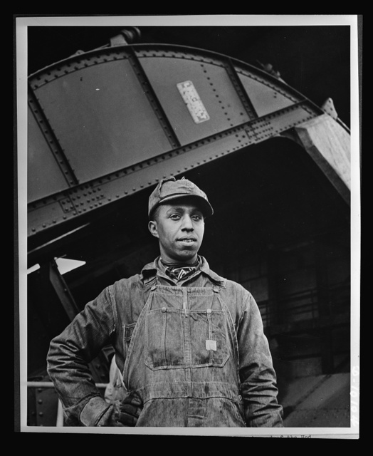 Negroes speed war work for Tennessee Valley Authority. Earl M. Qualls, car dumper operator at Watts Bar, is job steward of the Hod Carriers' local union on TVAuthority, and is active in combatting absenteeism and in furthering war bond Red Cross drives