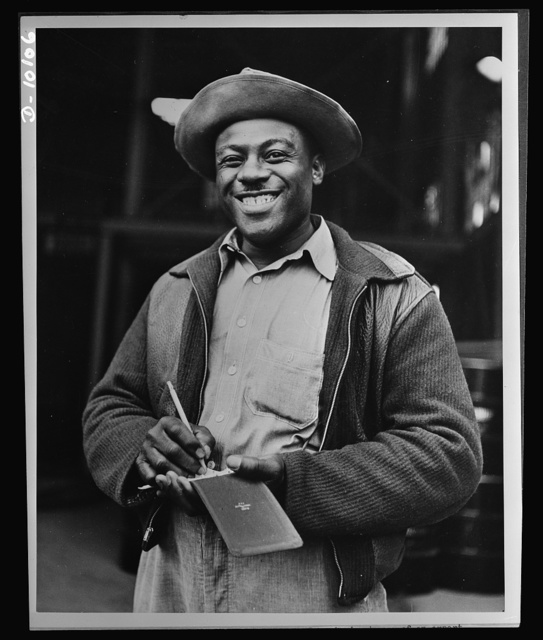 Negroes speed war work for Tennessee Valley Authority. Lincoln C. Johnson, sub-labor foreman at Wilson Dam, is in charge of an expert crew responsible for unloading carbide drums and having them on hand for reloading. Speedy work saves TVA money by avoiding demurrage on railway cars. He is vice-president of the Hot Carriers' local union and in the last few months has been business agent