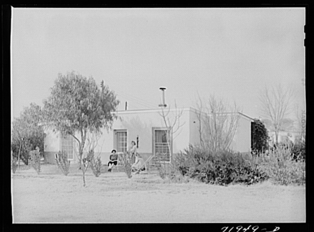 Neighbors meet at one of the houses at Camelback Farms, a FSA (Farm Security Administration) project at Phoenix, Arizona
