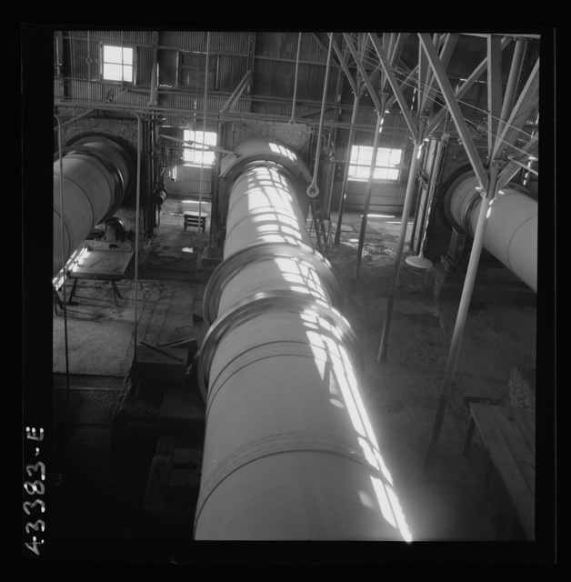New Idria, California. A rotary kiln at the mercury extraction plant of the New Idria Quicksilver Mining Company. A 1200 degree Fahrenheit heat drives off the sulphur and vaporizes the mercury which is later condensed