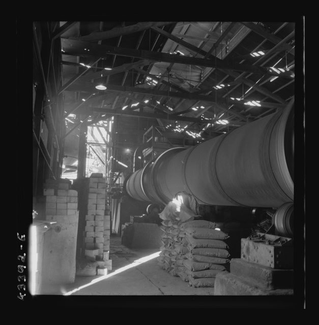 New Idria, California. A rotary kiln at the mercury extraction plant of the New Idria Quicksilver Mining Company. A 1200 degree Fahrenheit heat drives off the sulphur and vaporizes the mercury, later condensed