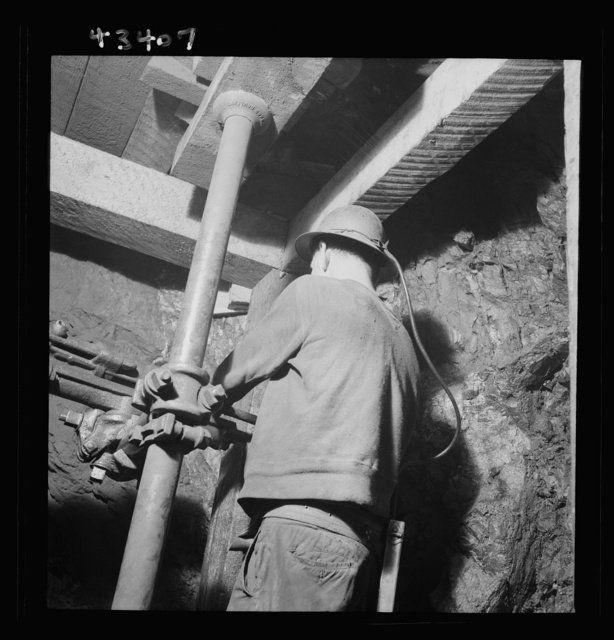 New Idria, California. Drilling blast holes with a compressed-air rock drill in one of the workings of the New Idria Quicksilver Mining Company, where cinnabar ore, containing mercury, is obtained