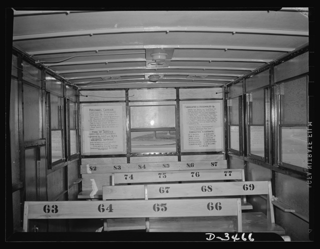 New oversize trailer for war workers. Interior of the new oversize bus trailer built almost entirely of non-critical material and designed by Office of Defense Transportation and War Production Board officials with cooperation of private companies. Containing eighty-seven seats(twenty-four drop seats will be installed later), the trailer has a seating capacity nearly three times that of an ordinary city bus and twice that of the largest type of street car. It's one solution to the problem of transporting defense workers from cities to outlying industrial plants
