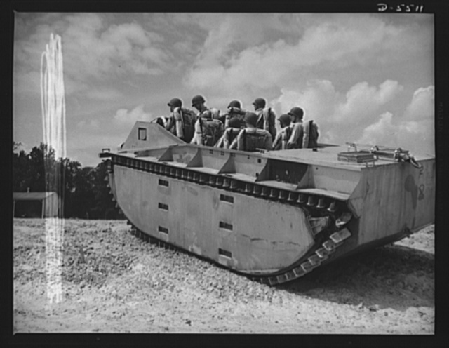 "New River, North Carolina. Marine amphibian tractor. ""The Marines have landed, and have the situation well in hand."" A special leatherneck unit, training with new amphibian tractors at New River, North Carolina, is ready for any shore opposition as its land-and-water troop carrier brings them ashore in full battle gear to establish a beachhead"