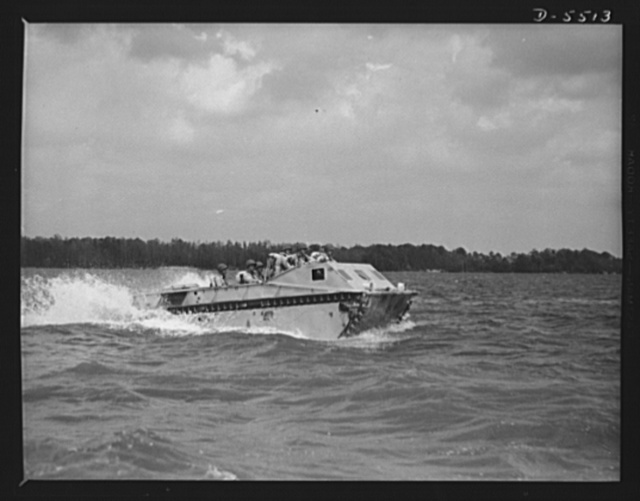 New River, North Carolina. Marine amphibian tractor. The soldiers of the sea have a new troop carrier that serves them well on land and in the water. A special Marine unit, training with an amphibian tractor at New River, North Carolina, is on its way from a battleship to establish a beachhead
