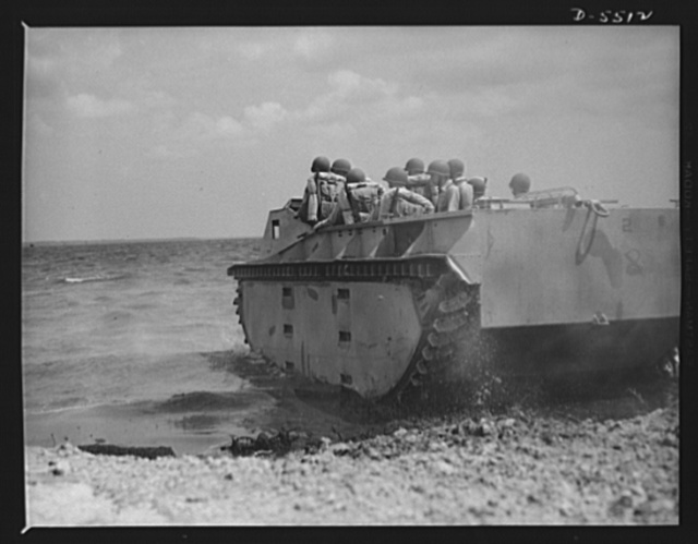 "New River, North Carolina. Marine amphibian tractors. ""Down to the sea"" in an amphibian tractor. A special Marine unit, in training with its new land-and-water troop carrier at New River, North Carolina, has accomplished its mission of establishing a beachhead and is now on its way back to its ship"