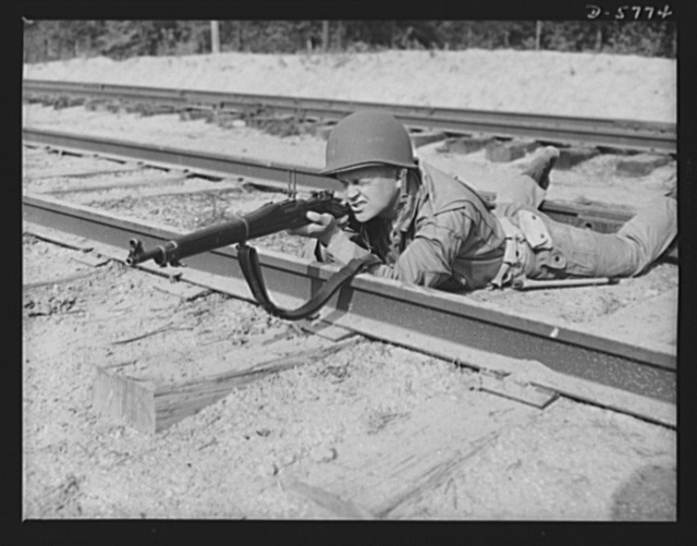 New River, North Carolina. Marine infantry. The Garand rifle [not shown here] does some of its best work in the hands of a hard, capable leatherneck. This Marine, in training at New River, North Carolina, knows how to make use of all the fighting advantages it offers. Marine srtg barracks, New River, North Carolina