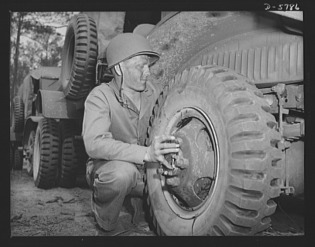 New River, North Carolina. Marine truck transport units. Marine transport workers in the fleet force are the most expert of tire changers. This man, in training at the New River, North Carolina base, takes them all ways: big ones, little ones, any way they come. Marine barracks, New River, North Carolina