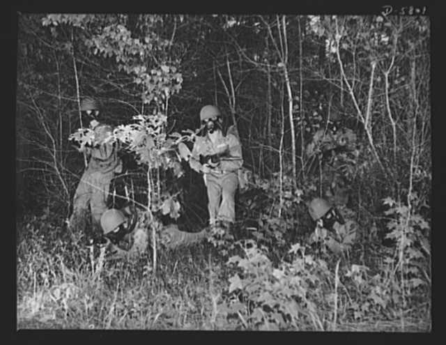 New River, North Carolina. Marines in training. Full battle gear makes the Marine infantryman a figure that will be decidedly unpopular in the best Axis circles. Four leathernecks, taking advantage of foliage cover, emerge from a thicket during war exercises at New River, North Carolina. Marine barracks, New River, North Carolina