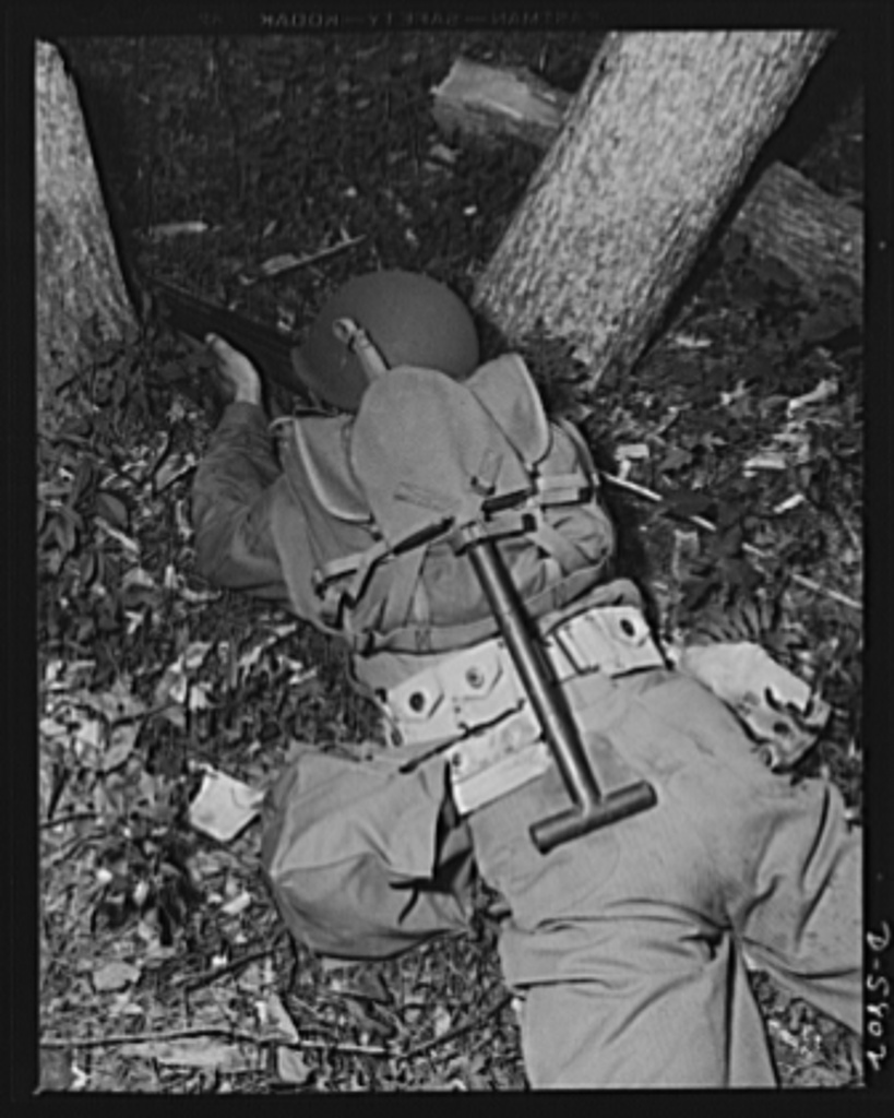 New River, North Carolina. Marines in training. Your modern leatherneck doesn't need a plumber's helper. When he goes into battle he carries the tools of his trade with him. He knows how to take advantage of all natural cover, as witnessed in the setup this man has made for himself during Marine war exercises at New River, North Carolina. Marine barracks, New River, North Carolina