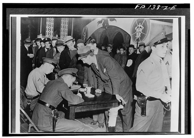 New York, New York. Army, Navy and Marine recruiting stations in all parts of the country have been besieged by long lines of young men. The total number of enlistments in December exceeded 60,000, 50 percent more than the greatest enlistment month of the last year