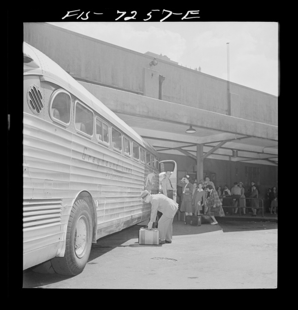New York, New York. Boarding interstate buses at the Greyhound bus terminal, 34th Street