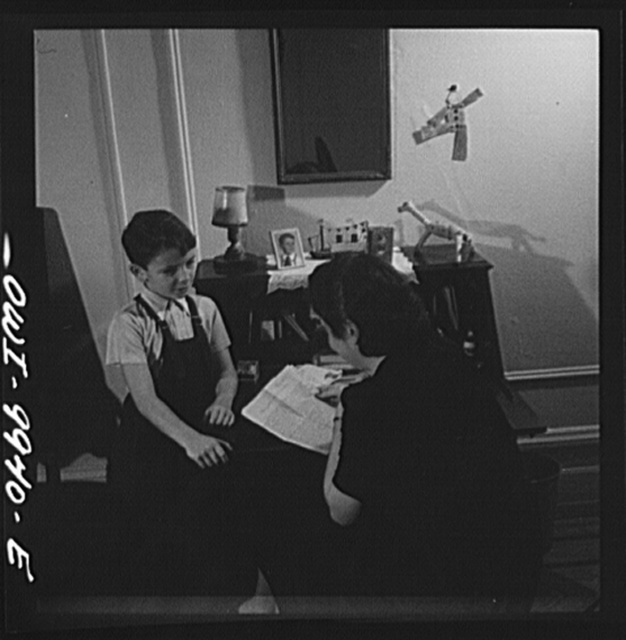 New York, New York. Children's Colony, a school for refugee children administered by a Viennese. German refugee woman reading a letter from her husband, a flier in the Royal Air Force