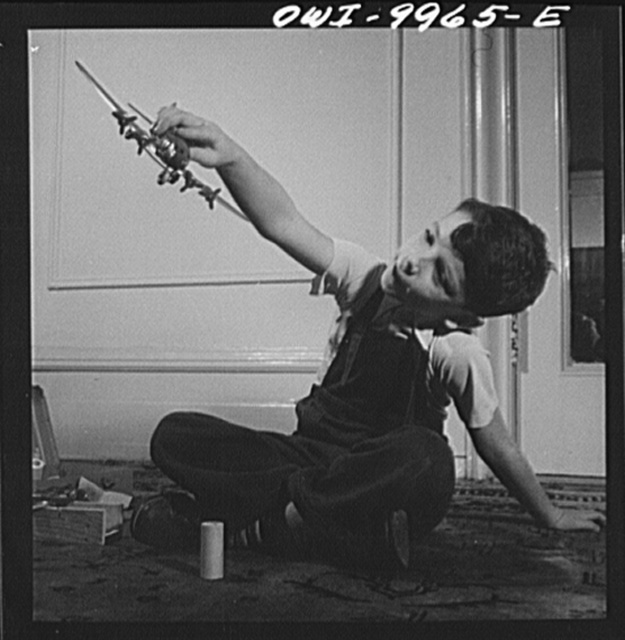 New York, New York. Children's Colony, a school for refugee children administered by a Viennese. German refugee child playing with airplane models
