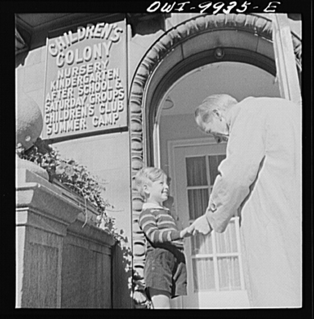 New York, New York. Children's Colony, a school for refugee children administered by a Viennese. Father bringing his son to school. Children of all nations come here and learn English rapidly