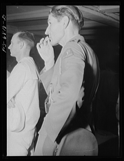New York, New York. Dutch officer and American sailor in the audience at the Stage Door canteen