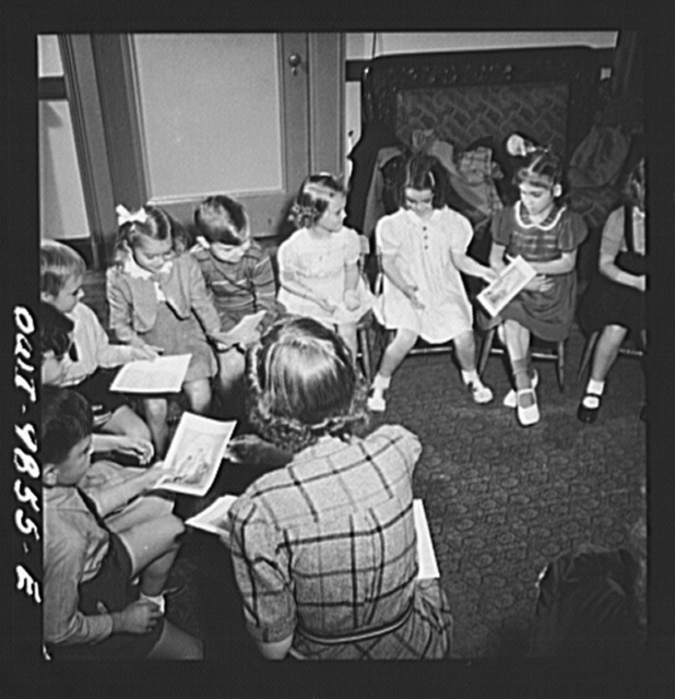 New York, New York. Janet and Marie (age six, second from right) Wynn [or Winn] attend Sunday school in the Jan Huss Church on East Seventy-third Street. Although most of the students and teachers are Czech-American, they conduct school in English. Marie's class receiving illustrations of the Bible story