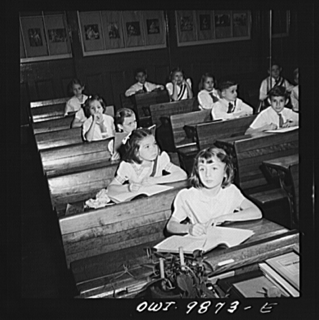 New York, New York. Janet Winn [or Wynn], a Czech-American child, (second from front), copying lesson from the blackboard in third grade in a public school