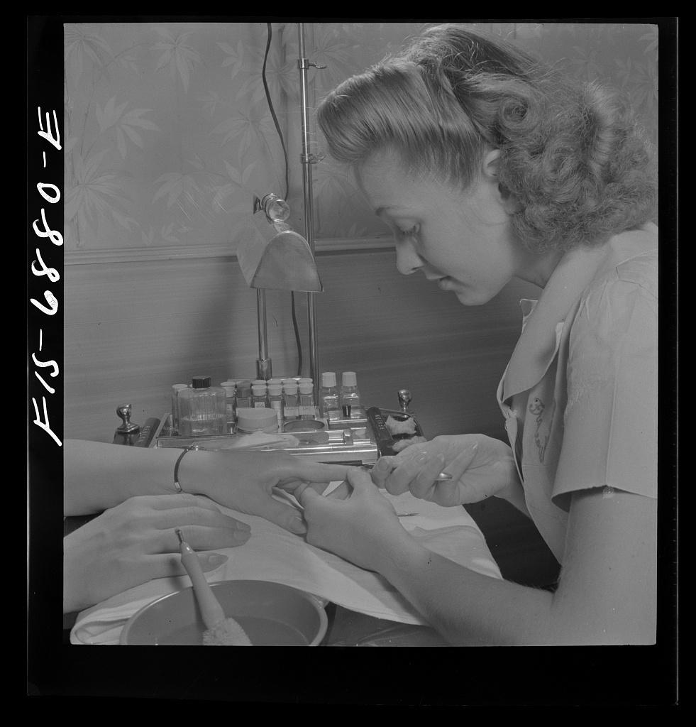 New York, New York. Manicurist at Francois de Paris, a hairdresser on Eighth Street
