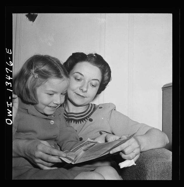 New York, New York. Martinetti's daughter and granddaughter examining a bond the child received for Christmas