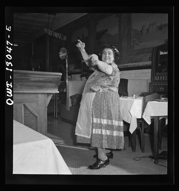 New York, New York. New Year's Eve in Marconi's Restaurant on Mulberry Street. This Gypsy woman is a habitue of the place. She came in for a bite to eat, and put on an extemporaneous dance to entertain the Di Contanzo's family party