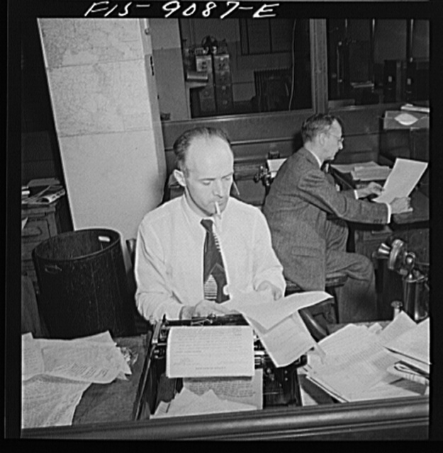 New York, New York. New York Times newspaper syndicate. Foreign newspapers and syndicates buy privilege of using Times news. The paper has so many correspondents all over the world, that often they scoop Associated Press and United Press. Swiss correspondent in foreground, Mexican in back