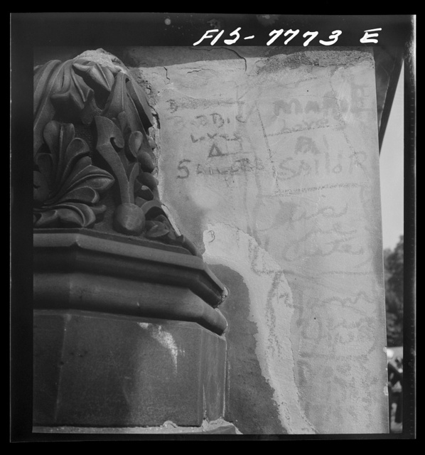New York, New York. Recent inscriptions on a stone railing on the mall in Central Park