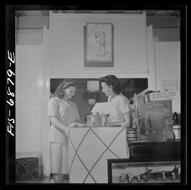 New York, New York. Receptionist making an appointment at Francois de Paris, a hairdresser on Eighth Street