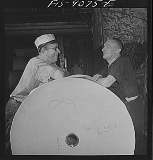 New York, New York. Reel room of the New York Times newspaper. Pressman resting between editions