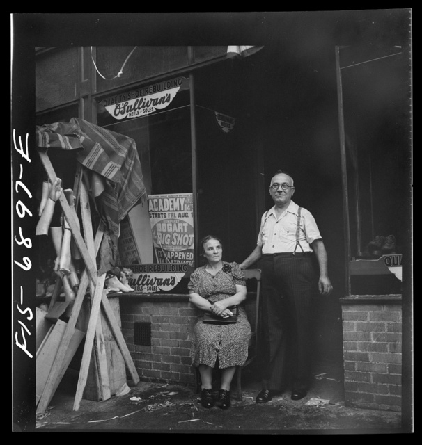 New York, New York. Shoemaker and his wife in the Italian section on Mott Street. Was images in honor of the feast of San Rocco at right