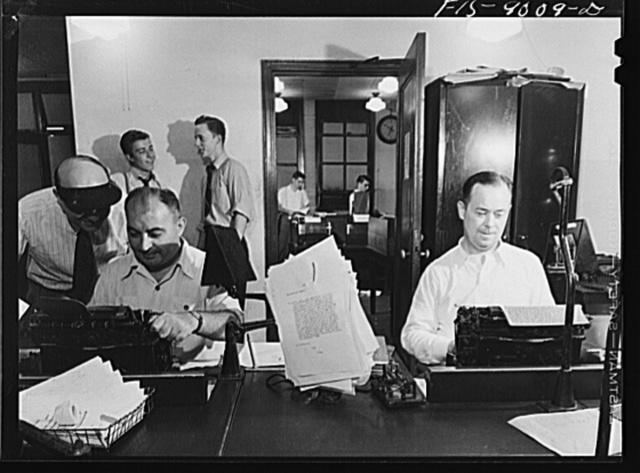 New York, New York. Telegraph room of the New York Times newspaper. News comes in from all over the country and abroad. Direct wire from Washington, D.C. Copy boys chatting in middle ground. In background is wire room with Associated Press and United Press wires