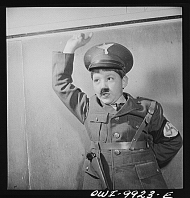 New York, New York. The Lincoln School of Teachers' College, Columbia University. Third-grade pupil acting the part of Hitler in a program produced by his class