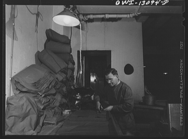 New York, New York. The War Emergency Board of the fur industry formed a fur vest project. Various fur factories donate the services of their employees one day a week to make fur-lined vests for the merchant marines. The fur in all from voluntary donations from the public. Jewish fur worker cutting outsides of fur-lined vests from heavy cotton cloth